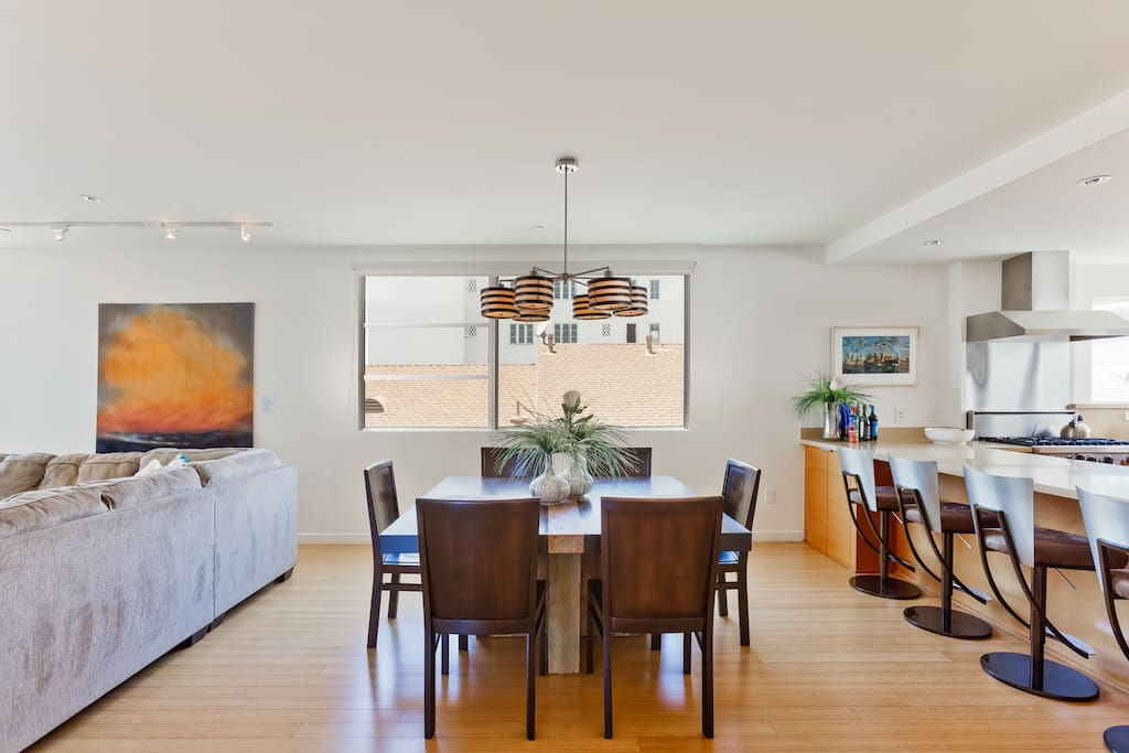 Open Floor Plan features a spacious Dining Room for 6 that flows between the Kitchen and Living Room and Balcony