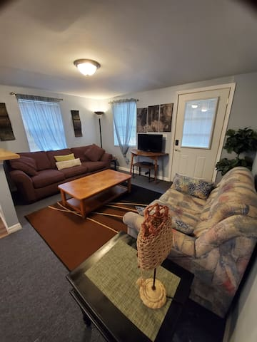 Living room offers a new couch and love seat. There is a TV with cable for your entertainment, with voice activated remote. Which is very handy if you don't know the channel number, just speak into your remote and it does the work for you!