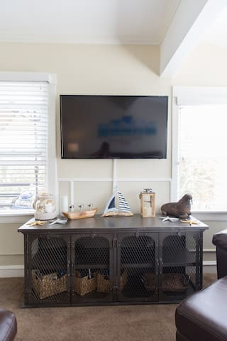 Smart TV in the living room with DVD player and tons of DVD's for your enjoyment
