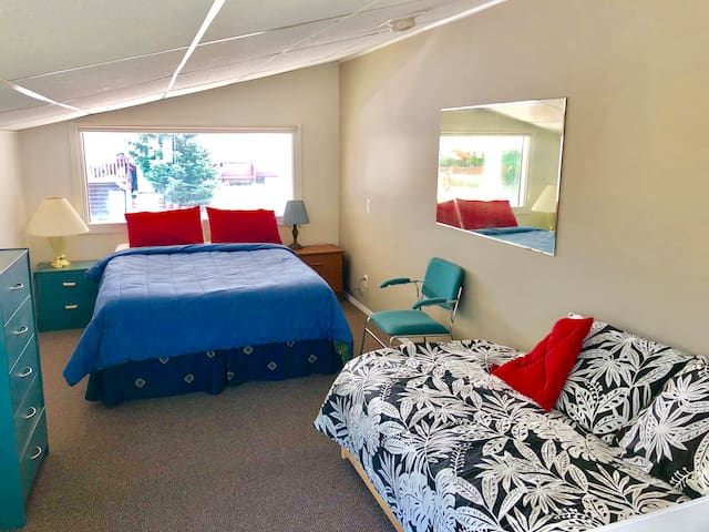 Queen size bed with couch for single person or couple.
