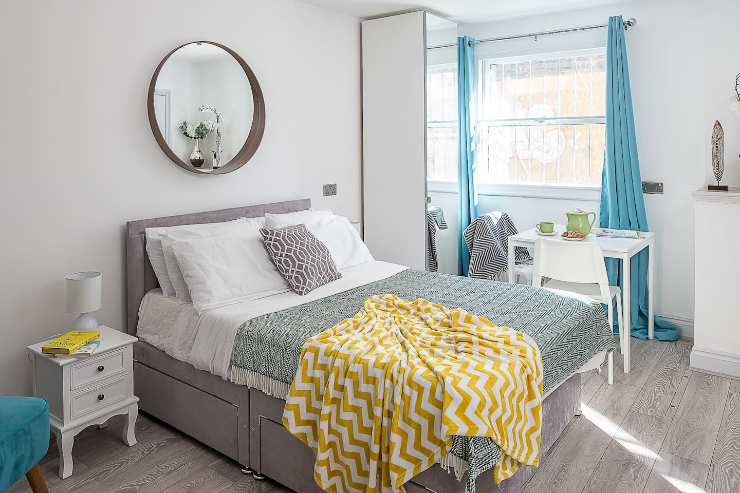 A large double bed with a memory foam mattress and a mattress topper for a comfortable stay. Designer mirror adds to the charm