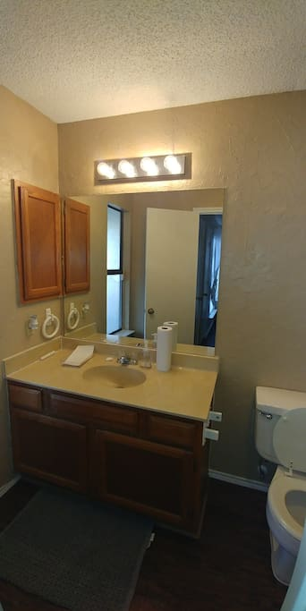 Beautifully decorated, cozy, and spacious en suite bathroom.