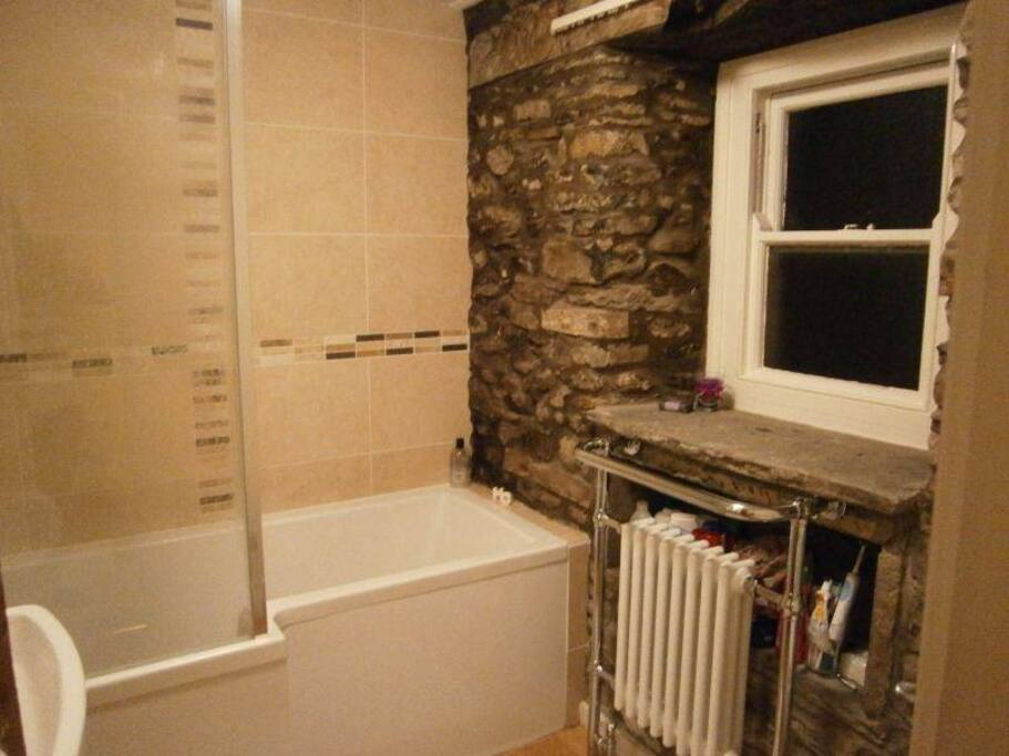 Power shower, exposed stone feature wall