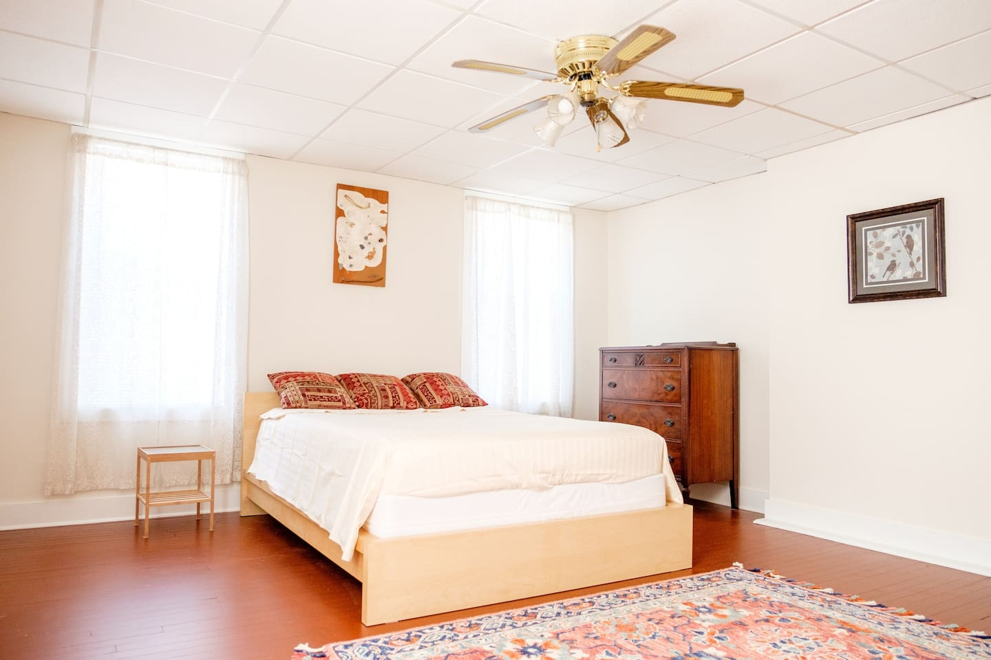 Beautiful bedroom with queen sized bed and comfort mattress.  This room is spacious with an office set-up, dresser, and closet for storing travel items.