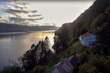 The slopes around Sofia`s house are steep down to the fjord. Drone-photo: Seger Emmers