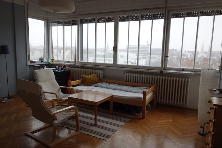 This is my bedroom, with access to the balcony. You are welcome to pass through to enjoy the balcony! (Or stop and have a tea with me and enjoy the view :))