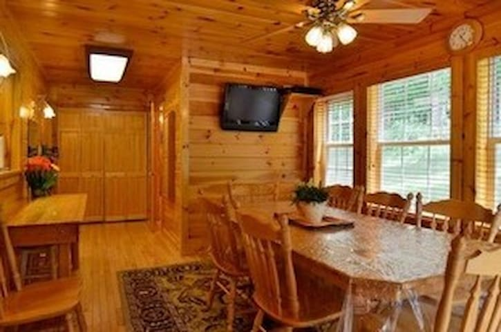 Large dining room with amazing views of wildlife in the back yard.