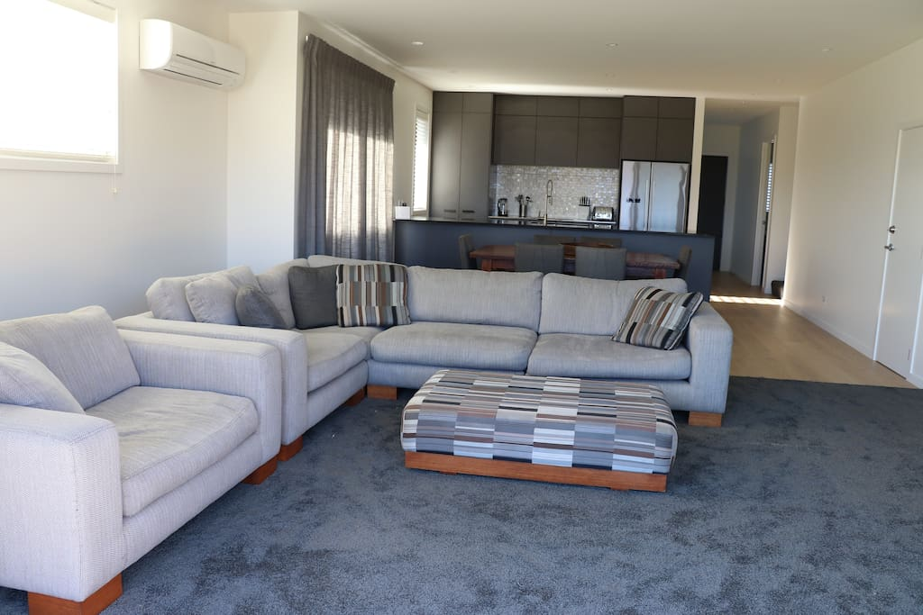 Open Plan lounge with Escea gas fireplace and internet TV