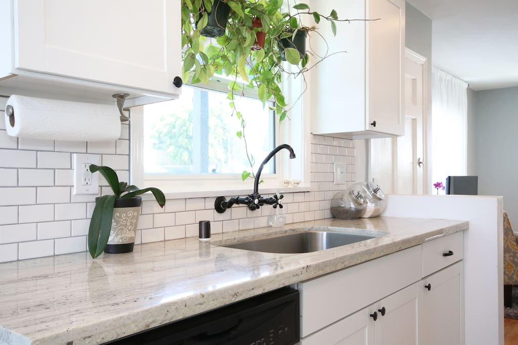 Kitchen (shared) - Beautiful quartz countertops and filtered water.