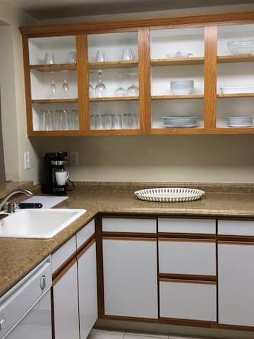 Kitchen with refrigerator, dishwasher, stove, microwave, coffee maker, toaster and blender. Dishes, utensils, pots, pans and baking sheets provided.