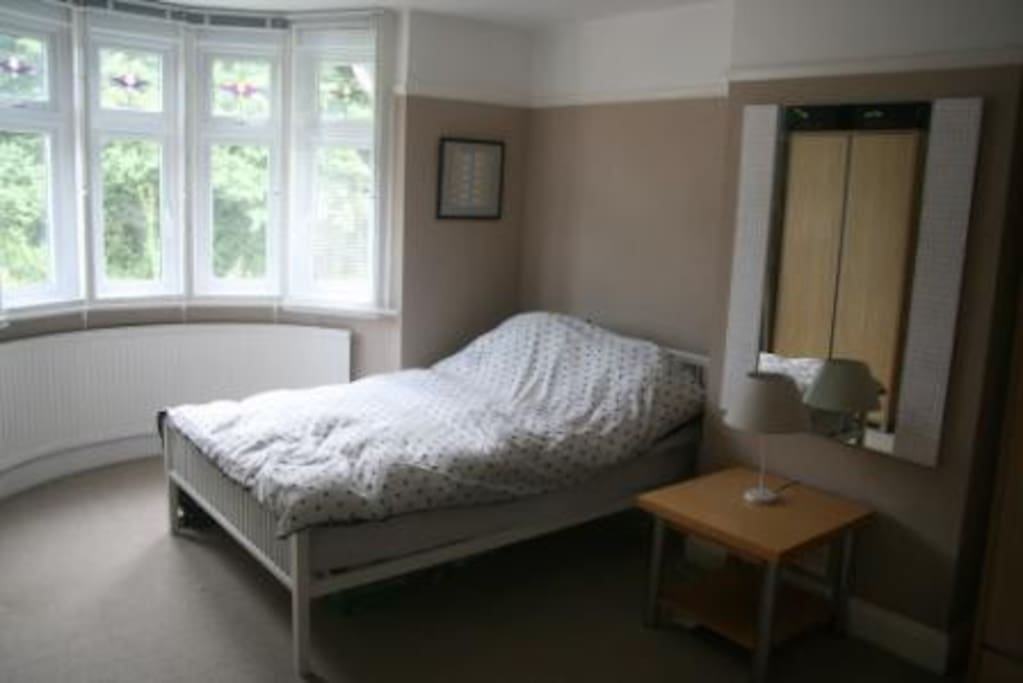 Main guest bedroom at the front of the house on the first floor