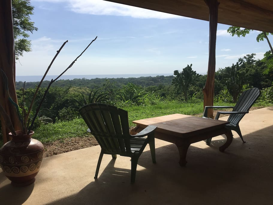 Dinning and sitting area over looking jungle and ocean