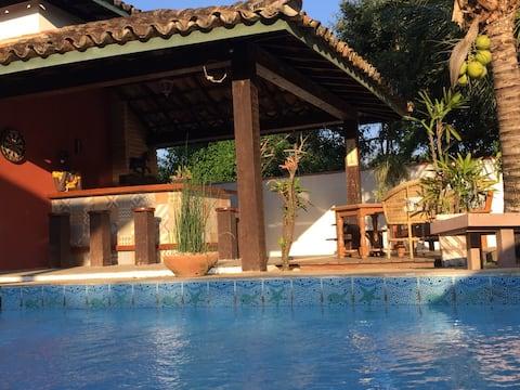 Loft com piscina churrasqueira perto da praia