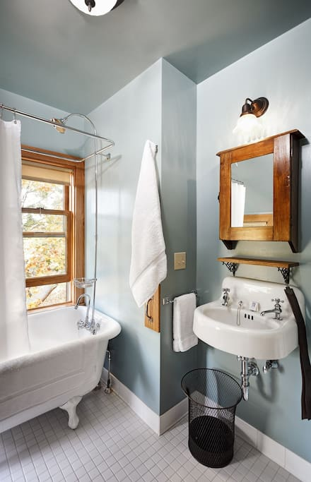 Maple room's private bathroom, claw foot tub with shower
