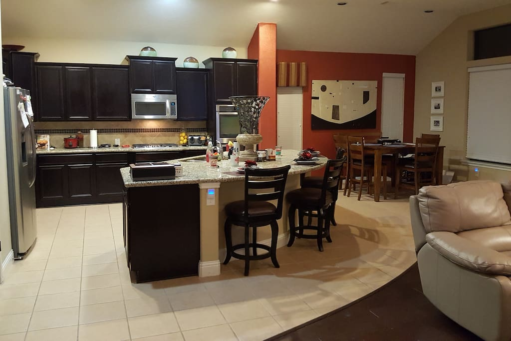 Large kitchen with 3 seat island and breakfast area.