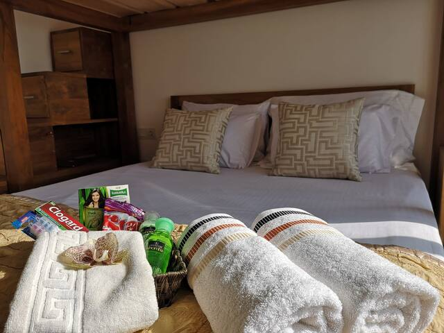 Second Bedroom with Teak Queen and Loft Bed Amenity basket with essentials