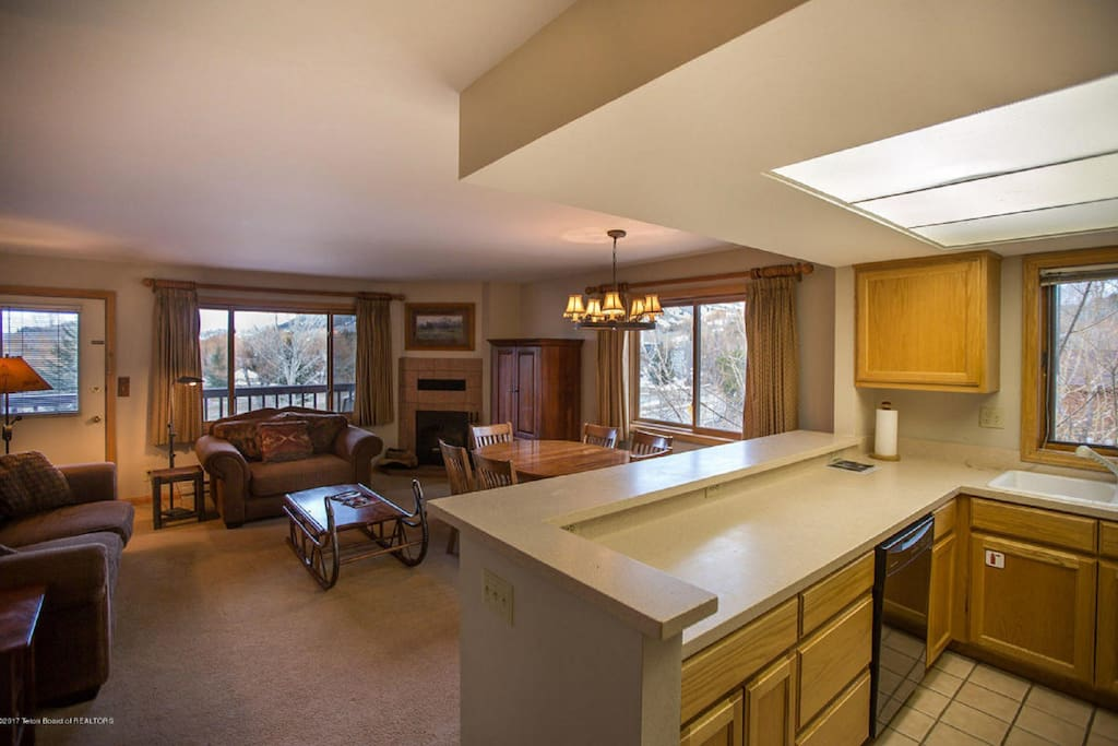Upper level with 1 bedroom, 1 full bathroom, full kitchen, and deck.