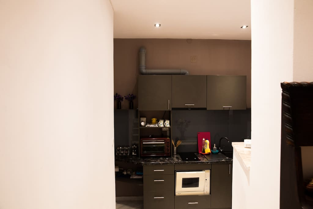The kitchen is fully equipped with everything you'd need for a longer or shorter stay