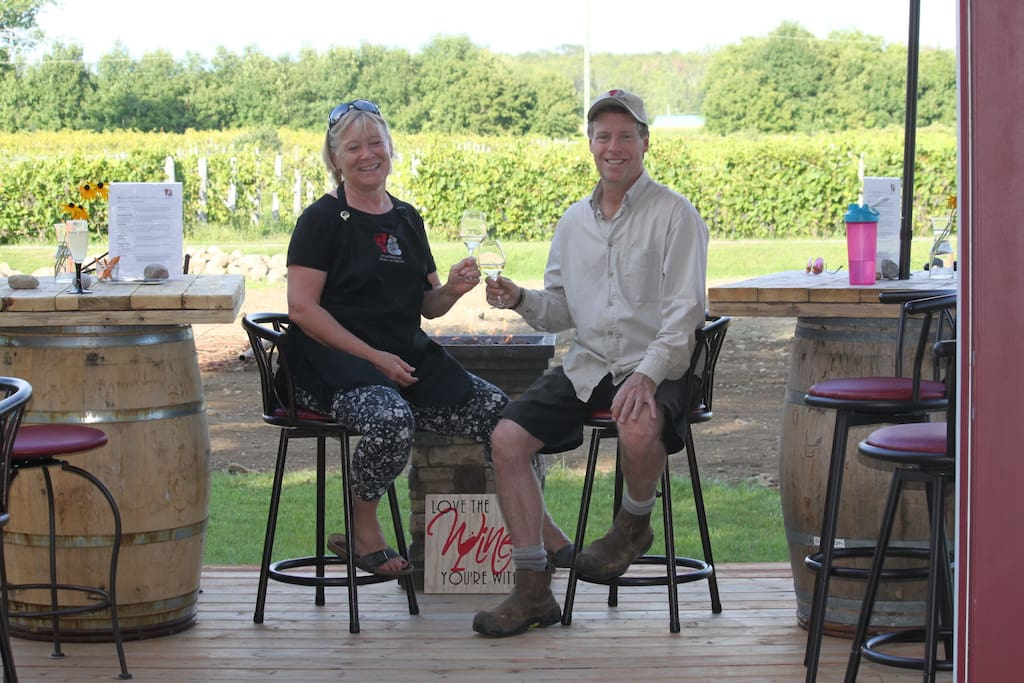 Your hosts sitting on the tasting room patio overlooking the vineyard.  Norene and Marc