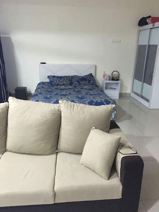 Comfortable bed with smooth couch