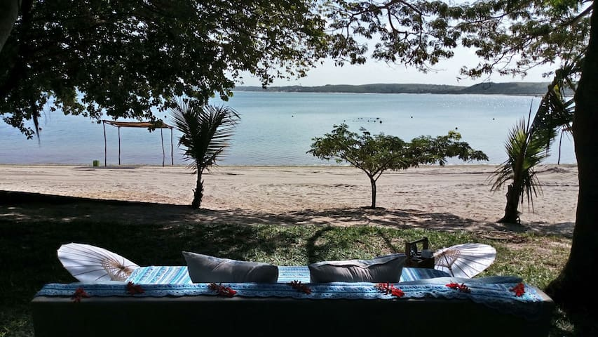 Beach log cabin on and overlooking 9km lagoon