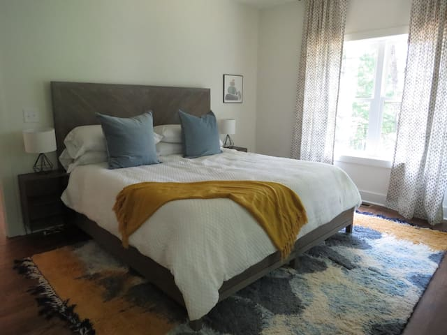 Master bedroom with king bed, private bath and views of the lake