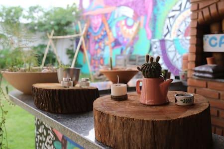 Casa no centro com horta orgânica