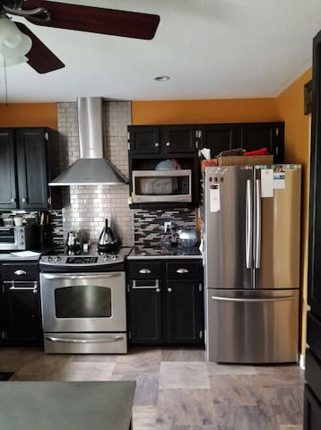 Large modern kitchen - Coffee available.