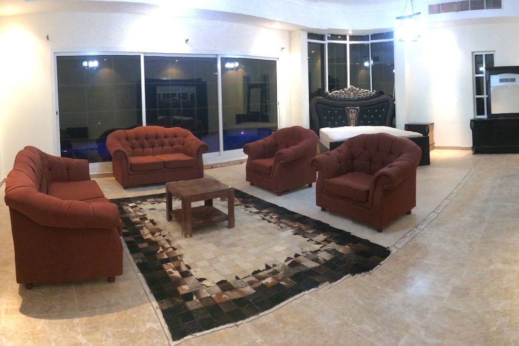 Massive Master Room with double bed, seating area, wardrobe. Glass sliding doors directly out to the pool. Private bathroom.
