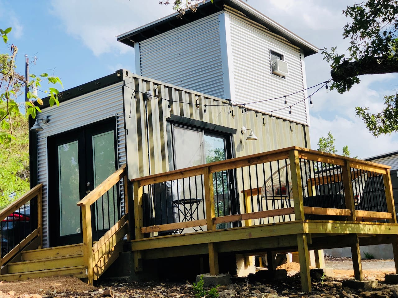 Tiny container guesthouse with deck