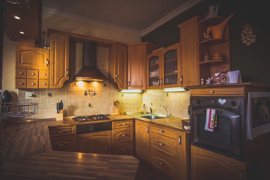 Fully equipped kitchen with large work space.