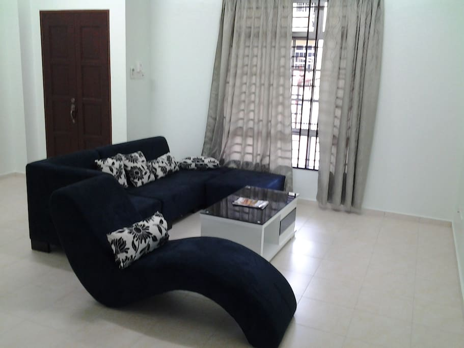 Living Room with Sofa, TV & Air Conditioner