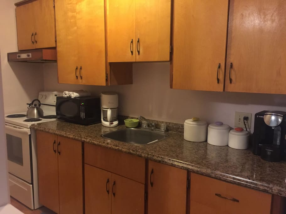 Gally kitchen with oven, fridge, microwave