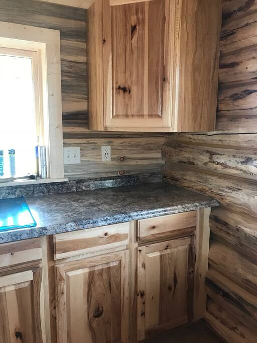 The cabins offer blue pine interior walls and hickory doors on the cabinets.