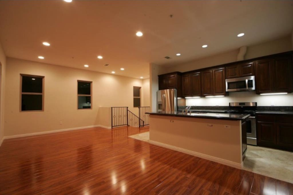 Come up to the open living space with the fully loaded kitchen.