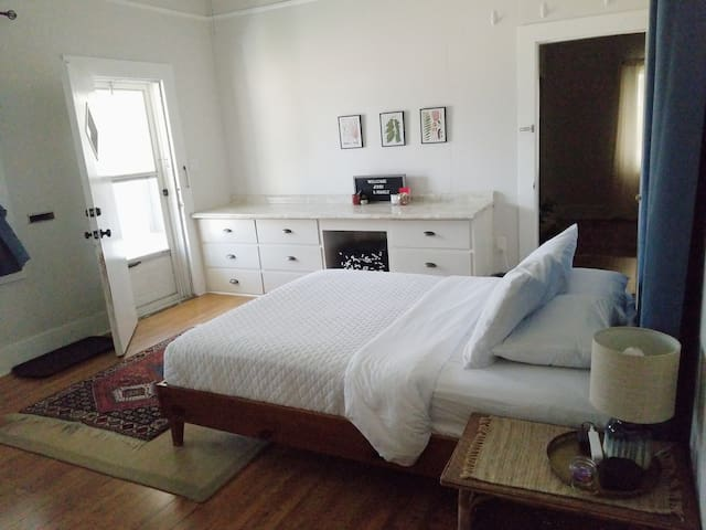 Bedroom 2 has a comfy Queen bed and a front door that leads to your entry porch.