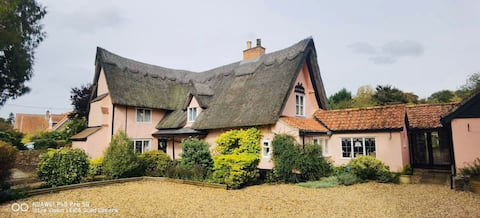 Beautiful Thatch Suffolk Cottage river frontage.