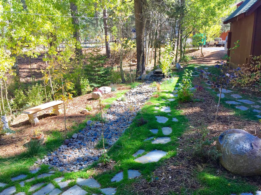 Front walk way with fountain and spring-time creek.