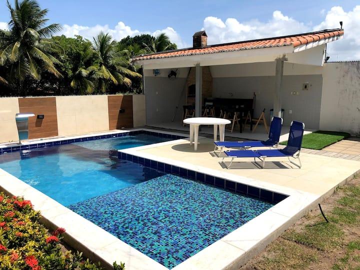 Casa com piscina e área de laser na praia BELA-PB