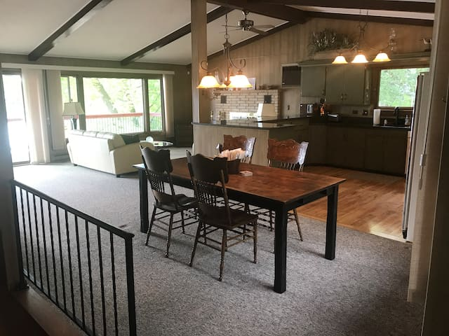 Main level has open concept with vaulted ceilings
