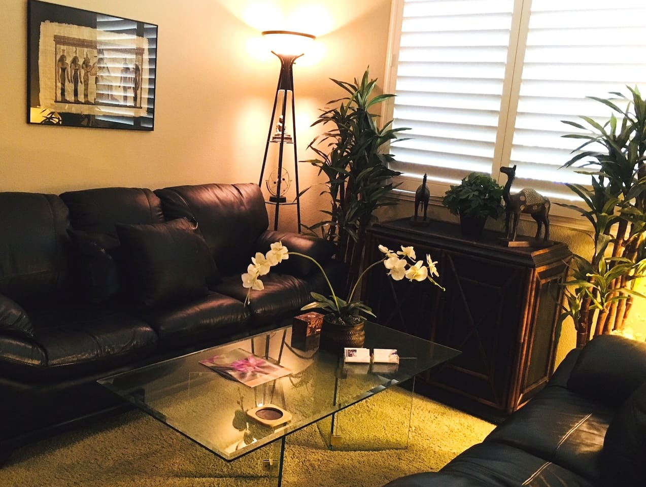 Entry Parlor Room - Feng Shui Design w/leather couch & love seat, silk plants, glass coffee table