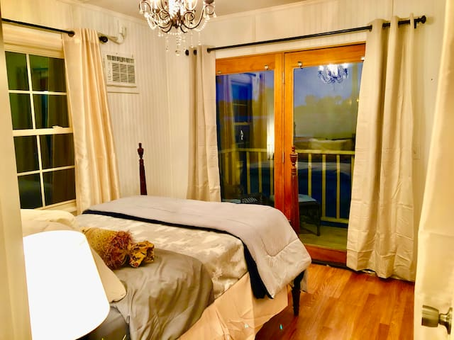 The second bedroom is smaller but has large windows and French doors that open to the deck overlooking the pond.
