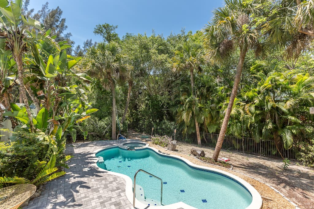 Take a dip in your private heated pool and hot tub surrounded by tropical vegetation.