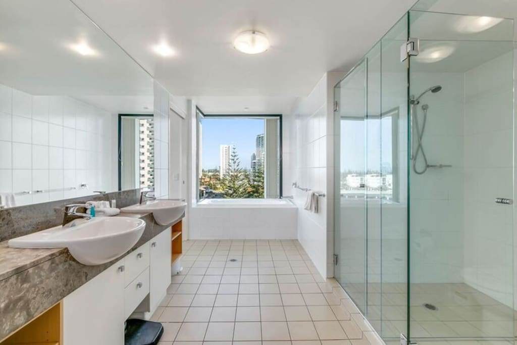 Spacious bathroom with his and hers vanity