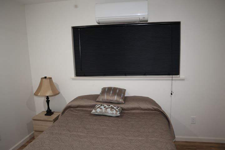 Bed Room with Queen Bed, individual AC Temperature Control, and ceiling fan