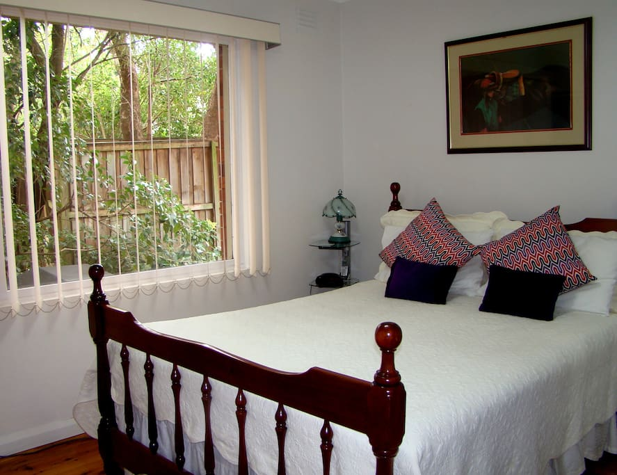 Master bedroom has a leafy outlook, firm queen bed, built in mirrored robe and an exciting ensuite