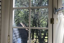 View from shower into the treetops and historic smokehouse