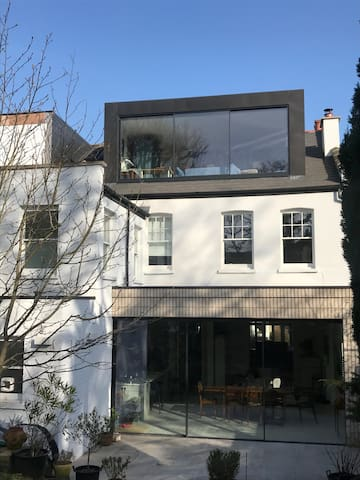 Rear of the house - your room is on first floor with view on South West facing garden.