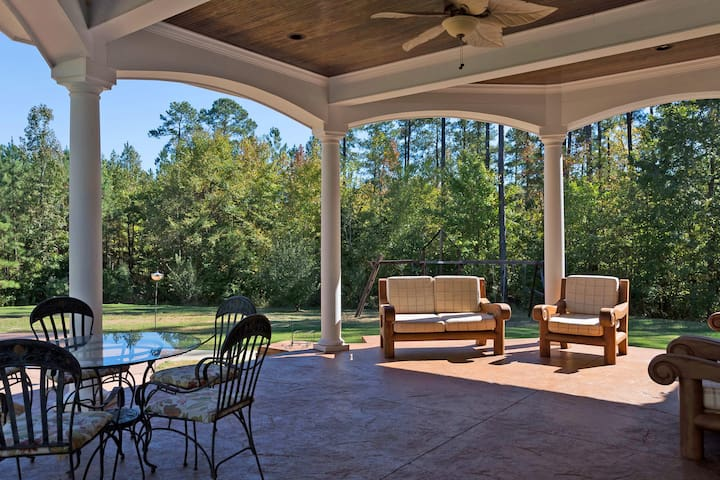 Stamped concrete in this covered porch with ceiling fan. Best dining area in the house. When weather permits!