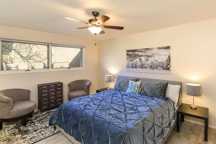 master bedroom with en-suite bath and king size bed.
